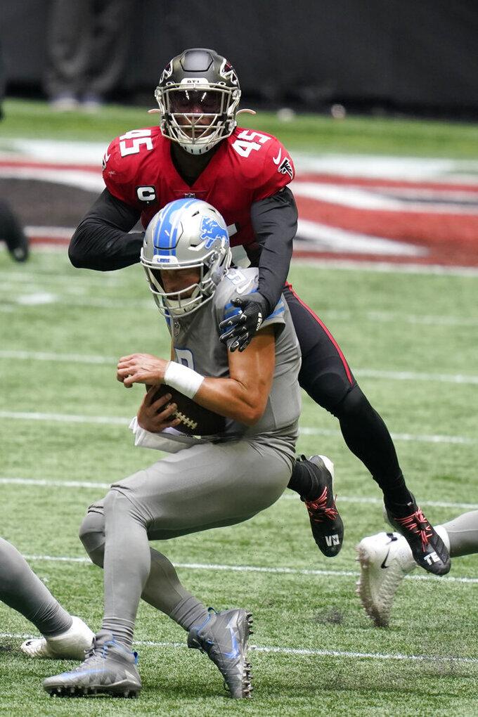 Atlanta Falcons linebacker Deion Jones (45) sacks Detroit Lions quarterback Matthew Stafford (9) during the second half of an NFL football game, Sunday, Oct. 25, 2020, in Atlanta. (AP Photo/Brynn Anderson)