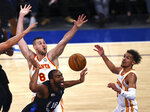 New York Knicks' Alec Burks (18) loses the ball as Atlanta Hawks' Danilo Gallinari (8) and Trae Young defend in the second quarter of Game 2 in an NBA basketball first-round playoff series Wednesday, May 26, 2021, in New York. (Elsa/Pool Photo via AP)