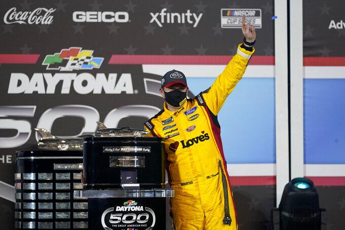 Michael McDowell celebrates after winning the NASCAR Daytona 500 auto race at Daytona International Speedway, Monday, Feb. 15, 2021, in Daytona Beach, Fla. (AP Photo/John Raoux)