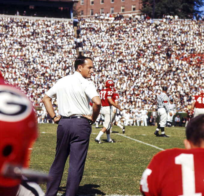 Coach Vince Dooley watches the game from the sidelines, 1965. (Floyd Jillson/Atlanta Journal-Constitution via AP)
