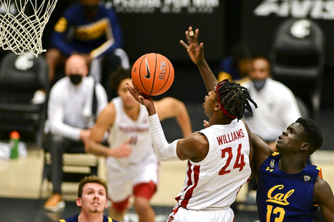 Washington State guard Noah Williams (24) releases a shot as California forward Kuany Kuany (13) defends during the first half of an NCAA college basketball game Thursday, Feb. 18, 2021, in Pullman, Wash. (AP Photo/Pete Caster)
