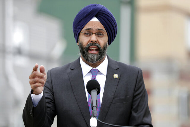 FILE - In this Aug. 1, 2018 file photo, New Jersey Attorney General Gurbir Grewal speaks during a news conference in Newark, N.J. Grewal announced on Thursday, June 25, 2020, that a Paterson city councilman, a councilman-elect and two other men face criminal voting fraud charges stemming from the May 12 special election in the city. . (AP Photo/Julio Cortez, File)
