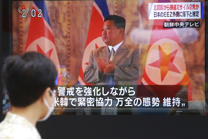 A man walks past a TV screen showing North Korean leader Kim Jong Un, in Tokyo, Wednesday, Sept. 15, 2021. North Korea fired two ballistic missiles into waters off its eastern coast Wednesday afternoon, two days after claiming to have tested a newly developed missile in a resumption of its weapons displays after a six-month lull. (AP Photo/Koji Sasahara)