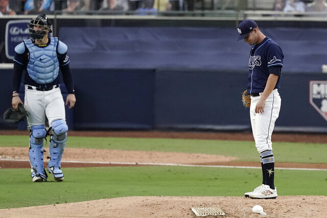 Tampa Bay Rays pitcher Shane McClanahan, right, waits to be relieved during the seventh inning in Game 6 of a baseball American League Championship Series against the Houston Astros, Friday, Oct. 16, 2020, in San Diego. (AP Photo/Jae C. Hong)