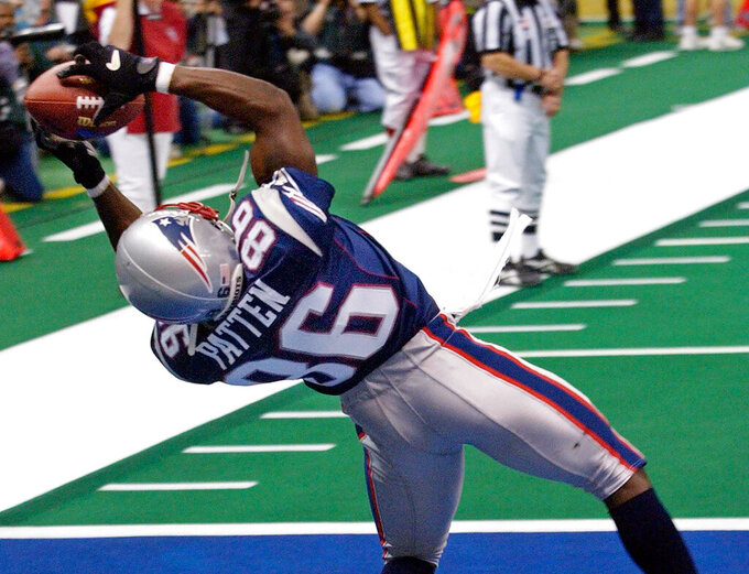 FILE - In this Feb. 3, 2002, file photo, New England Patriots wide receiver David Patten grabs a touchdown pass during the second quarter of Super Bowl XXXVI against the St. Louis Rams at the Louisiana Superdome in New Orleans, La. Patten, who caught Tom Brady's first postseason touchdown to help the Patriots win their first Super Bowl, was killed in a motorcycle accident on Thursday night, Sept. 3, 2021, outside of Columbia, S.C., Richard County coroner Naida Rutherford said in a statement. He was 47. Patten played 12 seasons in the NFL after signing as an undrafted free agent with the New York Giants in 1997.  (AP Photo/Kathy Willens, File)