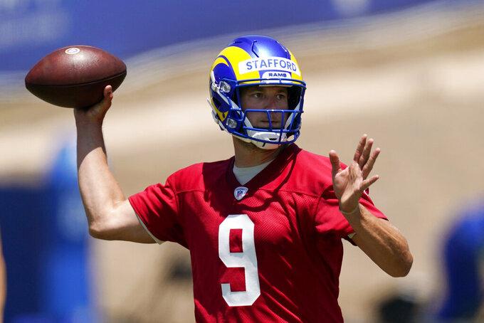 Los Angeles Rams quarterback Matthew Stafford passes during an NFL football practice Friday, June 4, 2021, in Thousand Oaks, Calif. (AP Photo/Mark J. Terrill)