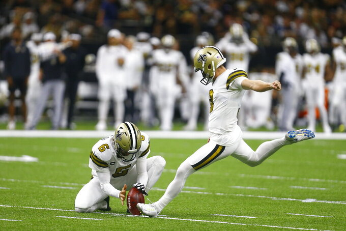 New Orleans Saints kicker Wil Lutz (3) kicks a field goal as Thomas Morstead (6) holds in the first half of an NFL football game against the Dallas Cowboys in New Orleans, Sunday, Sept. 29, 2019. The Saints won 12-10. (AP Photo/Butch Dill)