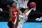 Baylor guard Matthew Mayer (24) shoots over Houston forward Justin Gorham, left, during the first half of a men's Final Four NCAA college basketball tournament semifinal game, Saturday, April 3, 2021, at Lucas Oil Stadium in Indianapolis. (AP Photo/Michael Conroy)