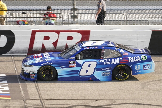 Dale Earnhardt Jr. (8) drives on the front stretch during the NASCAR Xfinity auto race in Richmond, Va., Saturday, Sept. 11, 2021. (AP Photo/Steve Helber)