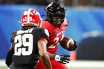 Cincinnati running back Jerome Ford (24) runs against Georgia during the first half of the Peach Bowl NCAA college football game, Friday, Jan. 1, 2021, in Atlanta. (AP Photo/Brynn Anderson)