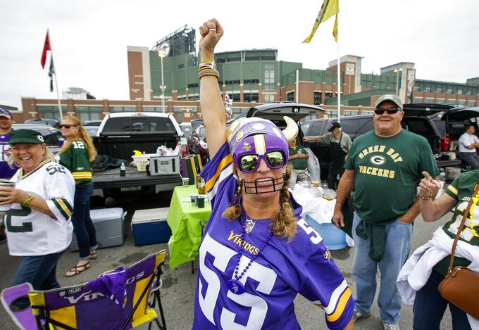 Jan Weiser tailgates before an NFL football game between the Green Bay Packers and the Minnesota Vikings Sunday, Sept. 15, 2019, in Green Bay, Wis. (AP Photo/Mike Roemer)