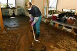 A man cleans a house devastated by Typhoon Hagibis, in Nagano, central Japan Wednesday, Oct. 16, 2019. The typhoon hit Japan's main island on Saturday with strong winds and historic rainfall that caused more than 200 rivers to overflow, leaving thousands of homes flooded, damaged or without power. (Iori Sagisawa/Kyodo News via AP)