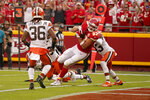 Kansas City Chiefs tight end Travis Kelce (87) scores as Cleveland Browns safety M.J. Stewart Jr. (36) watches during the second half of an NFL football game Sunday, Sept. 12, 2021, in Kansas City, Mo. (AP Photo/Charlie Riedel)