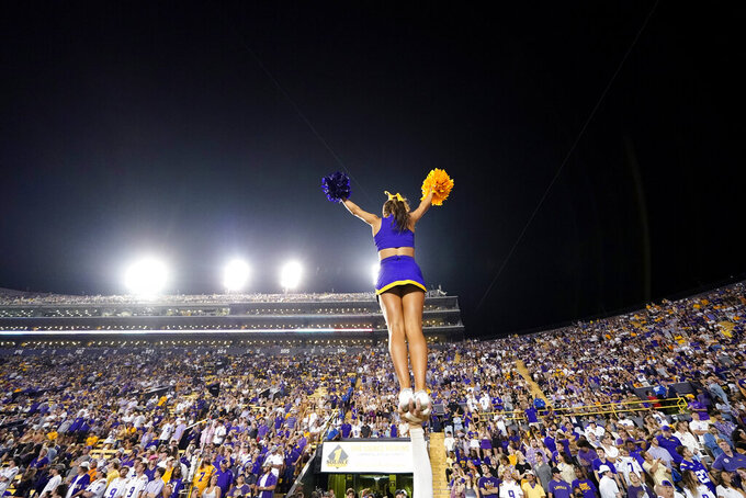LSU cheerleaders perform to a full stadium crowd, which resumed this season after nearly empty stadium last season due to the coronavirus pandemic, in the second half of an NCAA college football game against Auburn in Baton Rouge, La., Saturday, Oct. 2, 2021. Auburn won 24-19. (AP Photo/Gerald Herbert)
