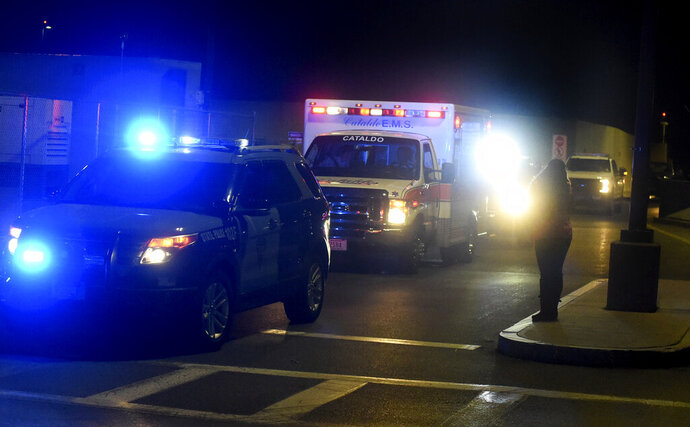 In this Monday, June 10, 2019 photo, a State Trooper vehicle leads the ambulance carrying David Ortiz from Logan to Massachusetts General Hospital, in Boston. Ortiz was back in Boston on Monday night for medical care, a day after authorities said the former Red Sox slugger affectionately known as Big Papi was ambushed by a gunman at a bar in his native Dominican Republic. (Jim Michaud/The Boston Herald via AP)