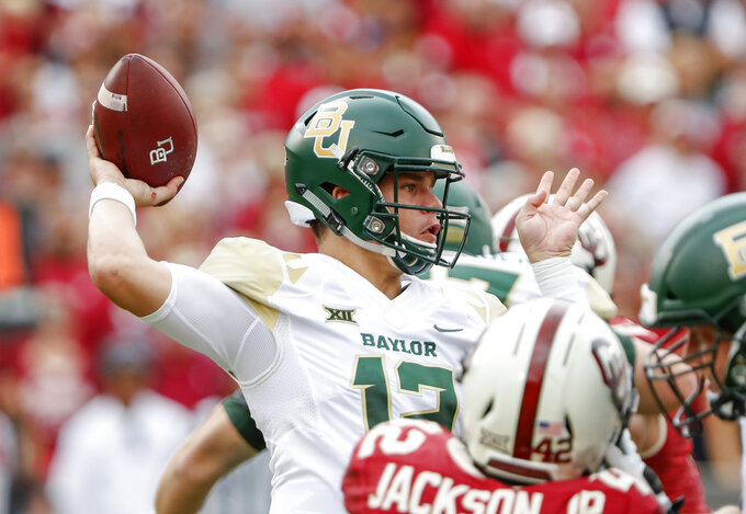 Baylor quarterback Charlie Brewer (12) passes the ball against Oklahoma in the first half of an NCAA college football game in Norman, Okla., Saturday, Sept. 29, 2018. (AP Photo/Alonzo Adams)