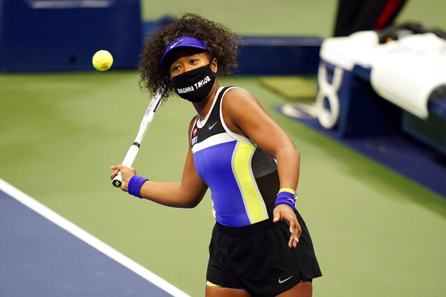 Naomi Osaka, of Japan, wears a mask in honor of Breonna Taylor as she celebrates after defeating Misaki Doi, of Japan, during the first round of the US Open tennis championships, Monday, Aug. 31, 2020, in New York. (AP Photo/Frank Franklin II)