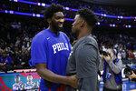Philadelphia 76ers' Joel Embiid, left, and Miami Heat's Jimmy Butler meet after an NBA basketball game, Saturday, Nov. 23, 2019, in Philadelphia. (AP Photo/Matt Slocum)