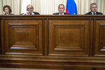 From left, France Defence Minister Florence Parly, Foreign Minister Jean-Yves Le Drian, Russian Foreign Minister Sergey Lavrov and Defence Minister Sergei Shoigu attend a news conference during their meeting in Moscow, Russia, Monday, Sept. 9, 2019. (AP Photo/Pavel Golovkin)