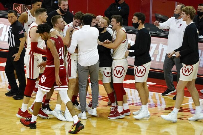 Indiana's Jerome Hunter walks back to his bench as Wisconsin players celebrate during a second overtime of an NCAA college basketball game Thursday, Jan. 7, 2021, in Madison, Wis. (AP Photo/Morry Gash)