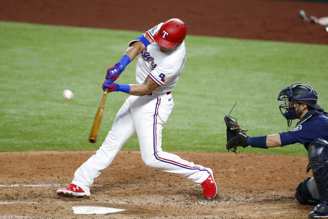 Texas Rangers Derek Dietrich connects for a double as Seattle Mariners catcher Austin Nola looks on in the fourth inning of a baseball game in Arlington, Texas, Wednesday, Aug. 12, 2020. (AP Photo/Tony Gutierrez)