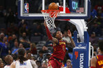 Cleveland Cavaliers guard Kevin Porter Jr. (4) watches his shot in front of Oklahoma City Thunder guard Chris Paul, left, and center Steven Adams, second from left, during the first half of an NBA basketball game Wednesday, Feb. 5, 2020, in Oklahoma City. (AP Photo/Sue Ogrocki)