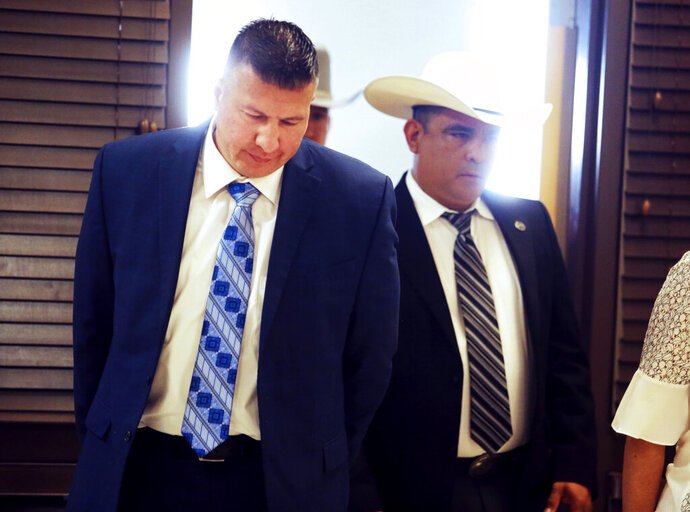 Edinburg Mayor Richard Molina walks into the courtroom before being arraigned by  Justice of the Peace Precinct 2 Jaime