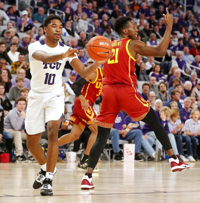 TCU guard Diante Smith (10) passes the ball behind Southern California forward Onyeka Okongwu (21) during the second half of an NCAA college basketball game in Fort Worth, Texas, Friday, Dec. 6, 2019. (Bob Booth/Star-Telegram via AP)