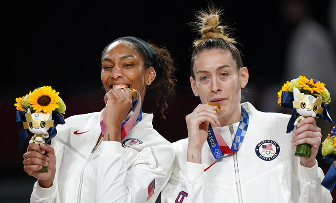 United States's Breanna Stewart, right, and A'Ja Wilson pose with their gold medals during the medal ceremony for women's basketball at the 2020 Summer Olympics, Sunday, Aug. 8, 2021, in Saitama, Japan. (AP Photo/Eric Gay)