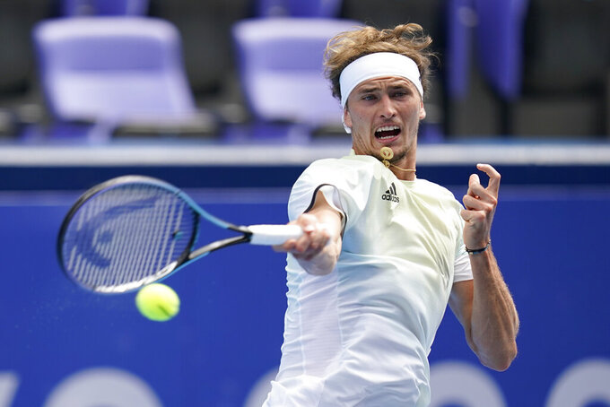Alexander Zverev, of Germany, returns to Daniel Elahi Galan, of Colombia, during second round of the tennis competition at the 2020 Summer Olympics, Monday, July 26, 2021, in Tokyo, Japan. (AP Photo/Patrick Semansky)