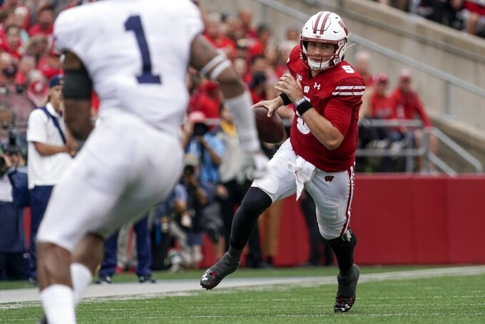 Wisconsin's Graham Mertz runs during the second half of an NCAA college football game against Penn State Saturday, Sept. 4, 2021, in Madison, Wis. Penn State won 16-10. (AP Photo/Morry Gash)