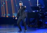 FILE - Juanes performs