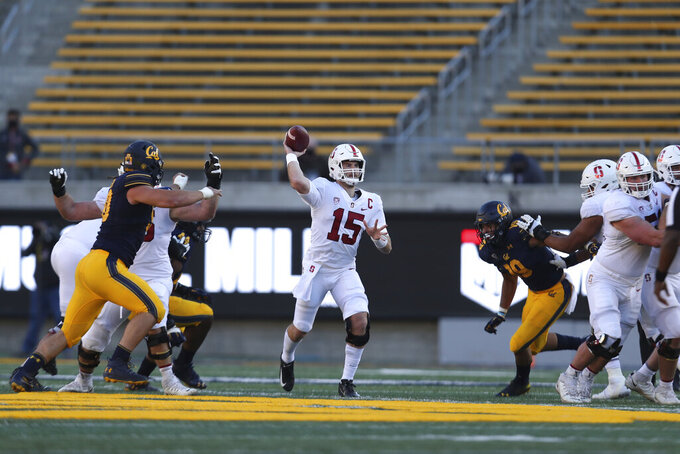 Stanford quarterback Davis Mills (15) throws a pass against California during the second half of an NCAA college football game Friday, Nov. 27, 2020, in Berkeley, Calif. (AP Photo/Jed Jacobsohn)