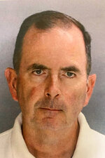 This booking photo provided by the Chester County District Attorney's Office shows Monsignor Joseph McLoone on Wednesday, Aug. 21, 2019. The Pennsylvania Roman Catholic priest is accused of stealing nearly $100,000 from his parish and spending it on a beach house and men he met on dating apps. The Chester County District Attorney's Office says McLoone was arrested Wednesday for theft from St. Joseph's Catholic Church in Downingtown, Pa.  (Chester County District Attorney's Office via AP)