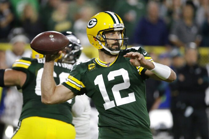 Green Bay Packers quarterback Aaron Rodgers drops back to pass during the first half of the team's NFL football game against the Philadelphia Eagles on Thursday, Sept. 26, 2019, in Green Bay, Wis. (AP Photo/Mike Roemer)