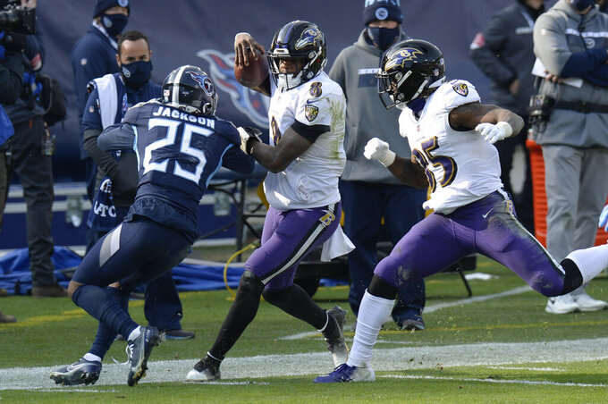 Baltimore Ravens quarterback Lamar Jackson (8) is pushed out of bounds by Tennessee Titans cornerback Adoree' Jackson (25) in the second half of an NFL wild-card playoff football game Sunday, Jan. 10, 2021, in Nashville, Tenn. (AP Photo/Mark Zaleski)