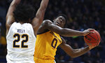 Arizona State guard Luguentz Dort, right, shoots as California's Andre Kelly defends during the first half of an NCAA college basketball game Wednesday, Jan. 9, 2019, in Berkeley, Calif. (AP Photo/Ben Margot)