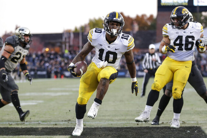 FILE - In this Nov. 3, 2018, file phoot, Iowa running back Mekhi Sargent (10) scores a touchdown against Purdue in the second half of an NCAA college football game in West Lafayette, Ind. The 20th-ranked Hawkeyes are looking to answer questions at running back ahead of their season opener next weekend. (AP Photo/AJ Mast, File)