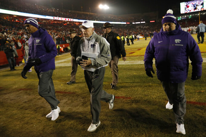 Kansas State head coach Bill Snyder, center, walks off the field after an NCAA college football game against Iowa State, Saturday, Nov. 24, 2018, in Ames, Iowa. Iowa State won 42-38. (AP Photo/Charlie Neibergall)