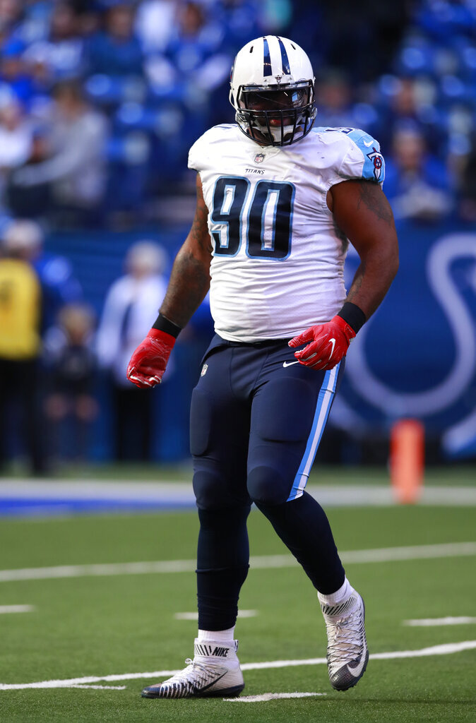 FILE - In this Nov. 26, 2017, file photo, Tennessee Titans defensive end DaQuan Jones (90) celebrates after a sack against the Indianapolis Colts during an NFL football game in Indianapolis. Jeffery Simmons, DaQuan Jones and Harold Landry are ready for the challenge of  filling the hole left by Tennessee trading five-time Pro Bowl defensive lineman Jurrell Casey to Denver in March. (AP Photo/Jeff Haynes, File)