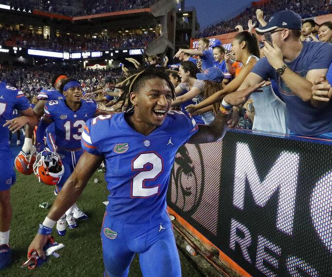Florida defensive back Brad Stewart Jr. (2) celebrates with fan after defeating LSU in an NCAA college football game, Saturday, Oct. 6, 2018, in Gainesville, Fla. Stewart intercepted an LSU pass in the final minutes of the game to help seal the win for Florida. (AP Photo/John Raoux)