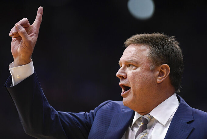 Kansas head coach Bill Self calls directions to his team against Texas during the second half of an NCAA college basketball game in Lawrence, Kan., Monday, Feb. 3, 2020. (AP Photo/Reed Hoffmann)
