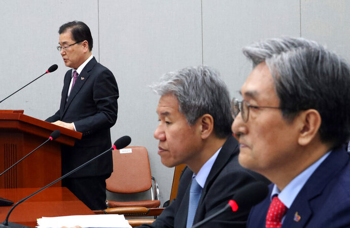 South Korean National Security Director Chung Eui-yong, left, speaks to lawmakers at the National Assembly in Seoul, South Korea, Thursday, April 4, 2019. Chung says his government is considering dispatching a special envoy to North Korea in an apparent effort to revive stalled nuclear talks. (Lee Jin-wook/Yonhap via AP)
