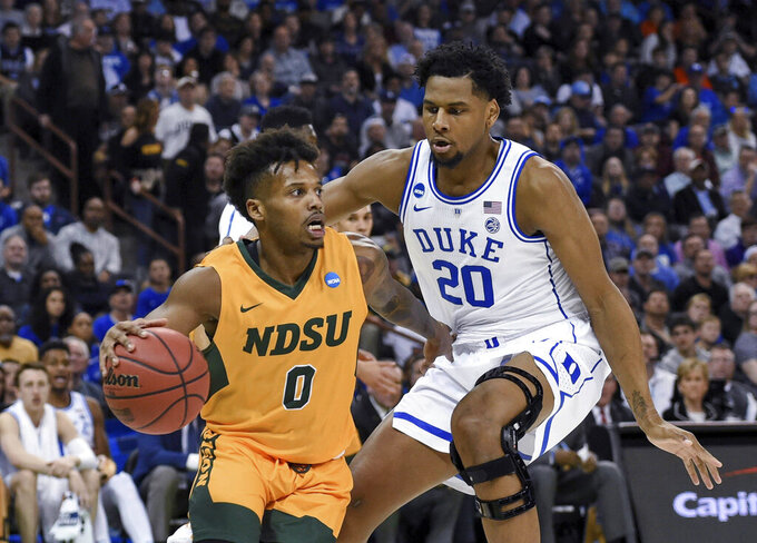 North Dakota State's Vinnie Shahid (0) drives against Duke's Marques Bolden (20) during the first half of a first-round game in the NCAA men's college basketball tournament in Columbia, S.C. Friday, March 22, 2019. (AP Photo/Richard Shiro)