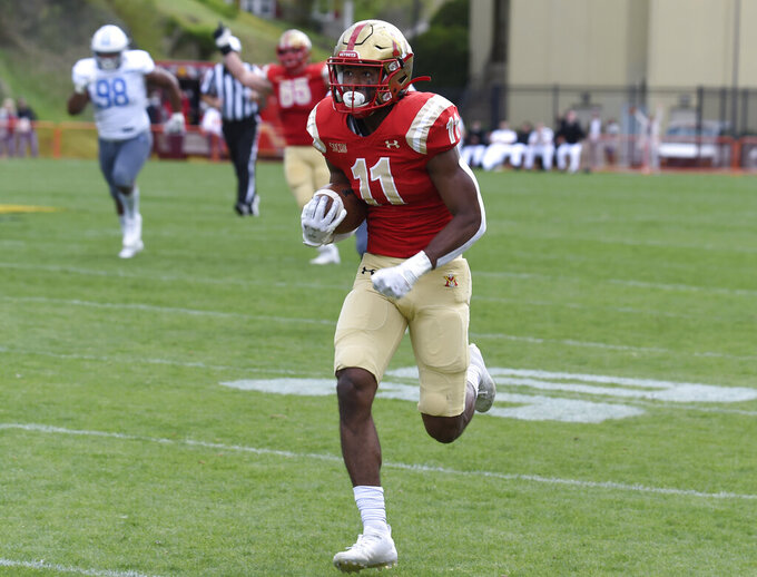 VMI receiver Michael Jackson breaks down the sideline after making a reception to score against The Citadel during an NCAA college football game, Saturday, April 17,2 021, in Lexington, Va. (David Hungate/Roanoke Times via AP)
