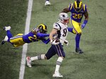 New England Patriots' Rob Gronkowski (87) runs against Los Angeles Rams' Nickell Robey-Coleman (23) during the first half of the NFL Super Bowl 53 football game Sunday, Feb. 3, 2019, in Atlanta. (AP Photo/Charlie Riedel)