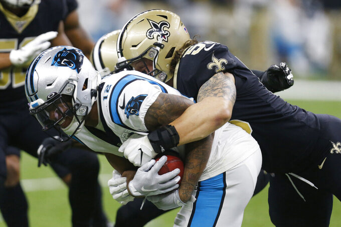 New Orleans Saints outside linebacker A.J. Klein (53) tackles Carolina Panthers wide receiver D.J. Moore (12), during the first half at an NFL football game, Sunday, Nov. 24, 2019, in New Orleans. (AP Photo/Butch Dill)