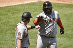 San Francisco Giants designated hitter Pablo Sandoval, right, celebrates with Evan Longoria after a two-run home run during the second inning of a baseball game against the Los Angeles Angels in Anaheim, Calif., Tuesday, Aug. 18, 2020. (AP Photo/Kelvin Kuo)