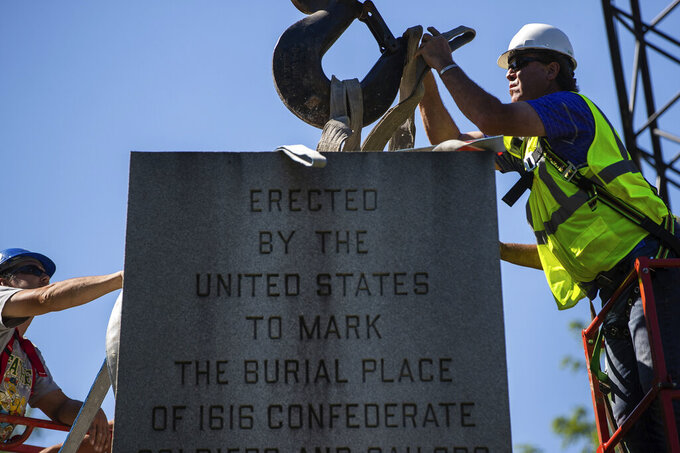 A monument dedicated to Confederate soldiers who died at a Union prison camp in Indianapolis is dismantled from Garfield Park in Indianapolis on Monday, June 8, 2020.   (Mykal McEldowney/The Indianapolis Star via AP)