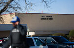 An officer walks near the scene after a church shooting at West Freeway Church of Christ on Sunday, Dec. 29, 2019 in White Settlement, Texas. (Juan Figueroa/The Dallas Morning News via AP)